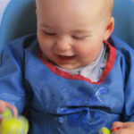 Boy in highchair