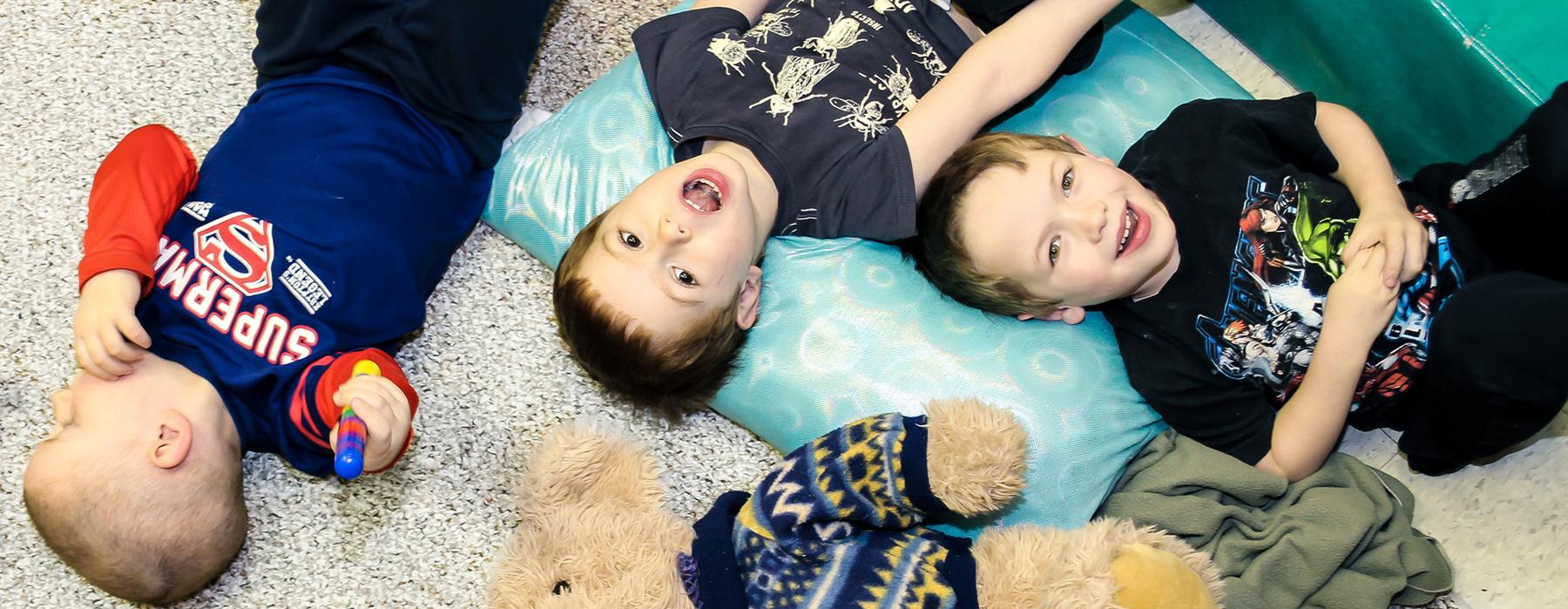 Boys lying on carpet